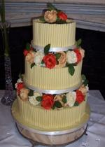 Chocolate Curl and Orange Rose Wedding Cake  Ref CW004