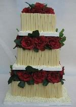 Square chocolate curl with red roses wedding cake Ref CW036